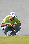 Ross Fisher lines up his putt on the 13th on day two of the Celtic Manor wales Open 2010.Picture Fran Caffrey/Newsfile.ie