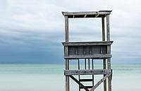 Rustic lifeguard stand overlooking the ocean.