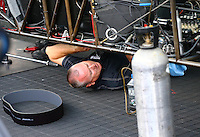 May 17, 2014; Commerce, GA, USA; A crew member works under the chassis of NHRA top fuel dragster Antron Brown during qualifying for the Southern Nationals at Atlanta Dragway. Mandatory Credit: Mark J. Rebilas-USA TODAY Sports