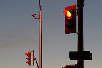Traffic Signal Lights at Dusk - Red Stop Light Illuminated
