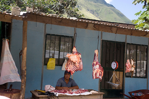 SIDES OF BEEF ARE HUNG OUT FOR CUSTOMERS AT A SANTA TERESA,PERU MEAT MARKET