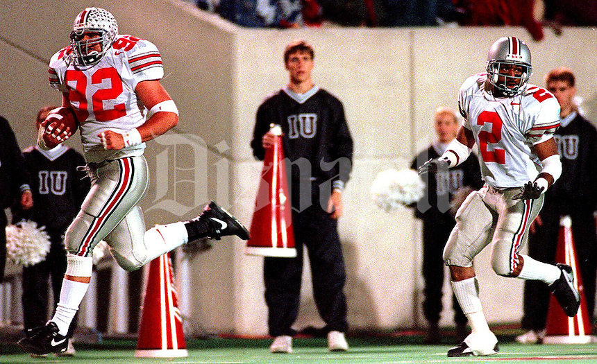 Ohio State's Matt Finkes (92) heads toward the end zone with Ty Howard keeping watch during the OSU-Indiana football game Saturday, November 16, 1996.  (Columbus Dispatch photo by CHRIS RUSSELL)