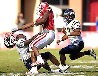 Florida International University Golden Panthers versus the University of Arkansas Razorbacks at Donald W. Reynolds Razorback Stadium, Fayetteville, Arkansas on Saturday, October 27, 2007.  The Razorbacks defeated the Golden Panthers, 58-10...FIU sophomore wide receiver Ashlyn Parker (11) (Port St. Joe, Fla.) loses his helmet in a collision with Arkansas tailback Darren McFadden (5) but still manages to hold on for the tackle.