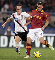 Calcio, Serie A: Roma vs Palermo. Roma, stadio Olimpico, 4 novembre 2012..AS Roma forward Pablo Daniel Osvaldo is challenged by Palermo defender Steve von Bergen, of Switzerland, left, during the Italian Serie A football match between AS Roma and Palermo, at Rome's Olympic stadium, 4 november 2012..UPDATE IMAGES PRESS/Riccardo De Luca