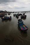 Fishing boats sit at low tide on the Cai River in Nha Trang, Vietnam. July 14, 2011.