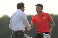 Phil Mickelson (USA) and Haotong Li (CHN) on the 18th green during the 2nd round of the WGC HSBC Champions, Sheshan Golf Club, Shanghai, China. 01/11/2019.<br /> Picture Fran Caffrey / Golffile.ie<br /> <br /> All photo usage must carry mandatory copyright credit (© Golffile   Fran Caffrey)