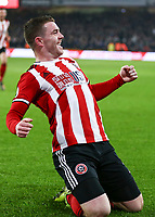 24th November 2019; Bramall Lane, Sheffield, Yorkshire, England; English Premier League Football, Sheffield United versus Manchester United; John Fleck  of Sheffield United slides on his knees after he scores in the 19th minute to make it 1-0 - Strictly Editorial Use Only. No use with unauthorized audio, video, data, fixture lists, club/league logos or 'live' services. Online in-match use limited to 120 images, no video emulation. No use in betting, games or single club/league/player publications