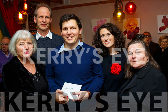 Ora Dunlevy presents the Hungarian conductor of the New Dingle Choir & Orchestra, Gabor Pelí with an appreciation gift in the Grey's Lane cafe, Dingle, after the performance at St Mary's church in the town on December 22nd last, L-R Orna Dunlevy, Thomas Meyer, Gabor Pelí, Bernadait De Brún and Margaret Nicgabhann.