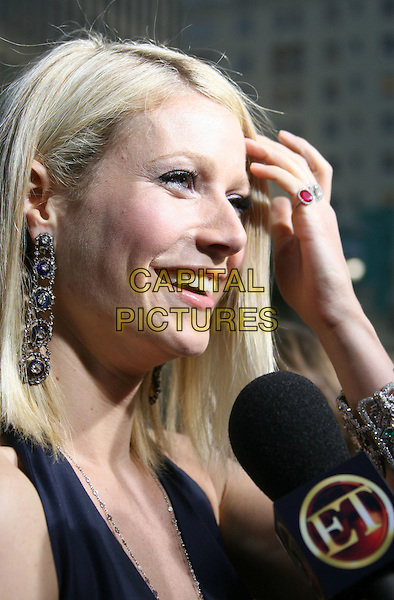 "GWYNETH PALTROW.""Iron Man"" Los Angeles Premiere held at the Grauman's Chinese Theatre, Hollywood, California, USA,.30 April 2008..portrait headshot microphone being interviewed hand ring profile.CAP/ADM/RE.©Russ Elliot/Admedia/Capital PIctures"