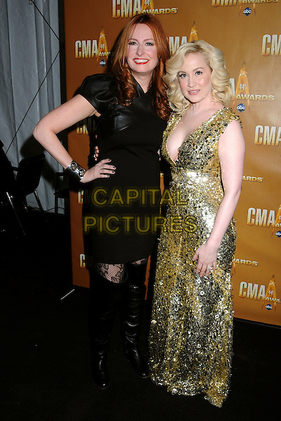 HILARY WILLIAMS & KELLIE PICKLER .44th Annual CMA Awards, Country Music's Biggest Night, held at Bridgestone Arena, Nashville, Tennessee, USA, 10th November 2010..CMAs country music full length gold sequined sequin long maxi sleeveless long maxi dress low cut cleavage black hand on hip .CAP/ADM/LF.©Laura Farr/AdMedia/Capital Pictures.