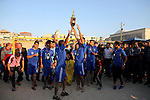 Palestinian players of Khadamat al-Shati club celebrate with Trophy after the beating al-Hilal club during the final football match of Beach Soccer Championship, in Gaza city on May 9, 2018. Photo by Mahmoud Ajour