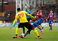 7th March 2020; Selhurst Park, London, England; English Premier League Football, Crystal Palace versus Watford; Etienne Capoue of Watford shoves Wilfried Zaha of Crystal Palace to concede a foul