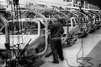 - FIAT Rivalta factory in Turin, worker at the assembly line (1985)....- stabilimento FIAT Rivalta a Torino, operaio alla catena di montaggio (1985)