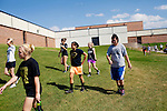 The varsity volleyball team heads to do some drills at Wright Senior High School in Wright, Wyoming August 2011. Wright's population teeters around 1,500. The town was settled in the 1970s with the start of the Black Thunder Coal Mine, one of the most productive in the United States.