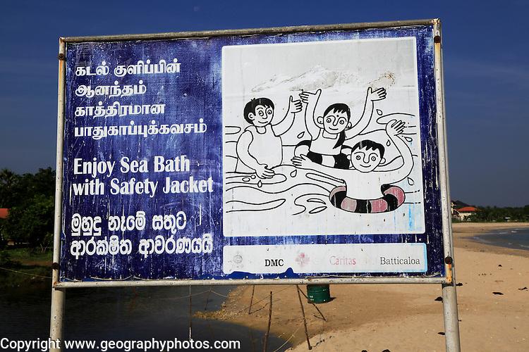 Information sign about bathing with safety jackets, Pasikudah Bay, Eastern Province, Sri Lanka, Asia