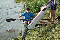 26 MAY 2013 - BRIGG, GBR - A competitor prepares to start the kayak leg of the 2013 Brigg Bomber Quadrathlon, a World Quadrathlon Federation World Cup round and the British Championships, held in Brigg in Lincolnshire, Great Britain .(PHOTO (C) 2013 NIGEL FARROW)