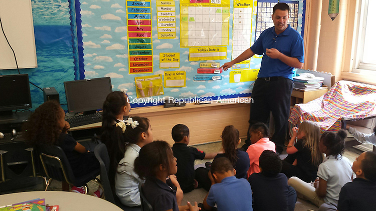 WATERBURY --  Washington Elementary School first grade teacher Jay Lanouette works with his class Wednesday.