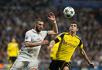 Real Madrid's French forward Karim Benzema and Christian Pullsic of Borussia Dortmund during the UEFA Champions League match between Real Madrid and Borussia Dortmund at the Santiago Bernabeu Stadium in Madrid, Tuesday, December 7, 2016.