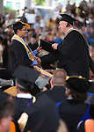 Interim President Chester Burton congratulates Erik Llamas during at the Western Nevada College commencement at the Pony Express Pavilion, in Carson City, Nev., on Monday, May 19, 2014. <br /> Photo by Cathleen Allison/Nevada Photo Source