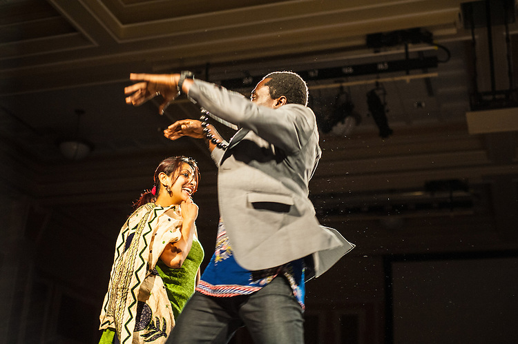 Mustapha Braimah, 1st year graduate student, and Rajita Thakur, a 2nd year graduate student, dance at the International Dinner in Baker University Ballroom on Saturday, November 17, 2012. Students of many different races and religions game together to enjoy one night of multicultural food and entertainment.