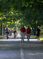 WEATHER PICTURE WALES<br /> Pictured: Cyclists ride along walkers on the Oystermouth Road path in Swansea Bay, Wales, UK. Wednesday 21 June 2017<br /> Re: A prolonged period of sunshine and high temperatures has caused one of the longest heatwaves in the UK.
