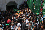 Relatives carry the body of Palestinian Mahmud Abu Jhaisha during his funeral, in the West Bank city of Hebron on April 26, 2015. Mahmud Abu Jhaisha, in his 20s, died on the way to a hospital after he was shot by Israeli police after he wounded a border police officer with a knife, the day before in Hebron. Photo by Mamoun Wazwaz