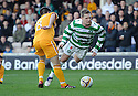 CELTIC'S KRIS COMMONS GOES OVER THE OUTSTRETCHED LEG OF MOTHERWELL'S STEVEN JENNINGS IN THE PENALTY BOX BUT REF CHARLIE RICHMOND WAVES PLAY ON