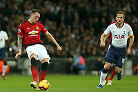 Phil Jones of Manchester United and Harry Kane of Tottenham Hotspur during Tottenham Hotspur vs Manchester United, Premier League Football at Wembley Stadium on 13th January 2019