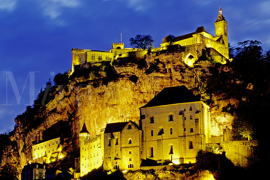 France, Dordogne, Perigord, Rocamadour, Midi-Pyrenees, Lot, Europe, The fortified pilgrimage town of Rocamadour situated on the terraced limestone cliffs is illuminated at night.