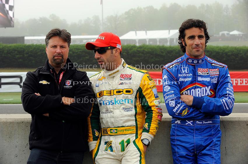 (L to R): Michael Andretti, Tony Kanaan (#11) and an impish Dario Franchitti (#10).