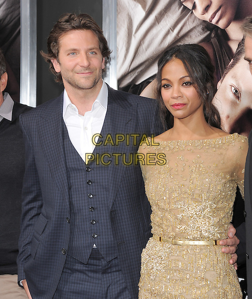 "Bradley Cooper, Zoe Saldana  .""The Words"" Los Angeles Premiere held at Arclight Cinemas, Hollywood, California, USA..September 4th, 2012.half length blue check white shirt stubble facial hair grey gray suit shirt dress belt waistcoat gold lace                                              .CAP/RKE/DVS.©DVS/RockinExposures/Capital Pictures."