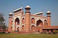 Agra, India.  Taj Mahal.  Gateway Entrance opening to the Taj and its Gardens.  Chhatris on Corners, Decorative Domes on Top.