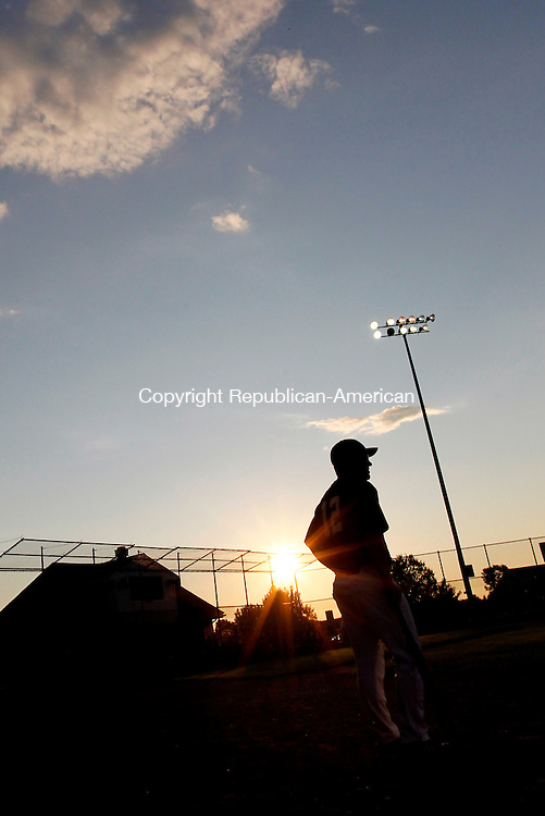 South Windsor, CT- 30, July 2010-073010CM13  Oakville Legion Post 195 head coach, Scott Ouellette is silhouetted against a setting sun during game 1 of the state finals.  His team defeated Branford, 4-1 forcing a game two.  --Christopher Massa Republican-American