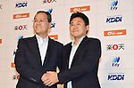 June 29th, 2011, Tokyo, Japan - Hiroshi Mikitani, right, CEO of Japan's online retailer Rakuten shakes hands with Takashi Tanaka, President of Japans KDDI during a news conference in Tokyo on Wednesday, June 29, 2011. Rakuten announced its cooperation with KDDI for electronic money. (Photo by Koichi Mitsui/AFLO)