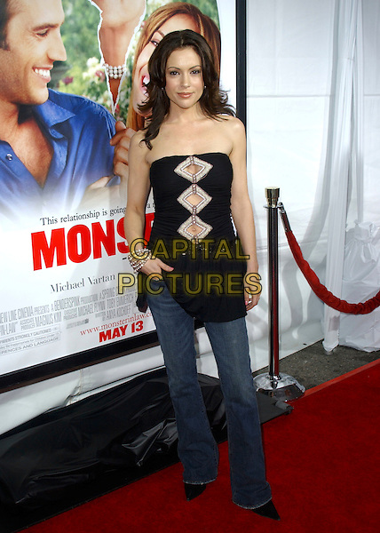 "ALYSSA MILANO.At New Line Cinema's Los Angeles Premiere of ""Monster-in-Law"" held at The Mann National Theatre in Westwood, California, USA,.April 29th 2005..full length black strapless top cut out hole tummy belly button jeans hand in pocket boob tube.Ref: DVS.www.capitalpictures.com.sales@capitalpictures.com.©Debbie VanStory/Capital Pictures"