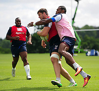Elliott Stooke of Bath Rugby is tackled. Bath Rugby pre-season training session on August 9, 2016 at Farleigh House in Bath, England. Photo by: Patrick Khachfe / Onside Images