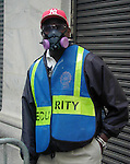 A police officer outside the NYSE wears a protective asbestos mask three days after the attacks on the World Trade Center.