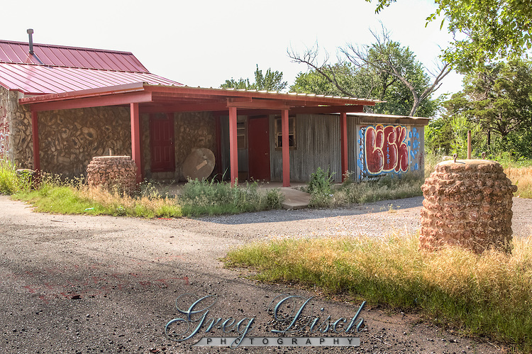 The Pioneer BBQ in Wellston Oklahoma on Route 66 sits on the remains of Pioneer Camp, a former tourist camp.  The round stone bases are what is left of an archway over the entrance to the camp.