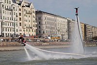 Sportsmen ride a water propelled Flyboard on river Danube in front of the Hungarian Parliament in downtown Budapest, Hungary on Sept. 29, 2017. ATTILA VOLGYI