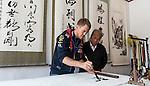 Infiniti Red Bull Racing driver Sebastian Vettel in Beijing - Chinese calligraphy