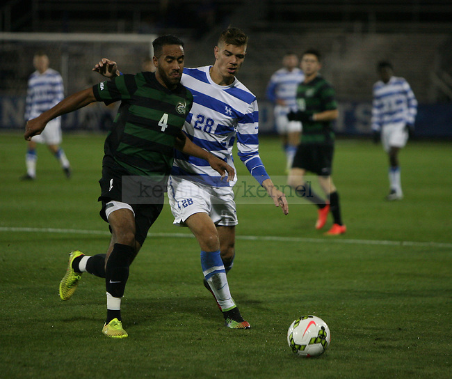 Freshman Forward, Stefan Stojkovic(28) fights for the ball during the UK vs. Charlotte mens soccer game for the Conference USA title. Friday, November 7, 2014 in Lexington. Photo by Joel Repoley | Staff