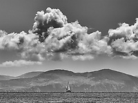 A sailboat cruises in Dingle Bay.