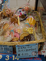Dogs cakes are sold in a cafe called Deco's Dog Cafe that sells dog snacks including cakes and other snacks in Tokyo, Japan. <br /> 20-Jan-2011