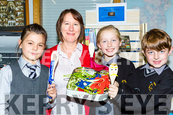 Anne Fitgerald who held an arts and Crafts class in the Castleisland Library on Tuesday with Gaelcoil Aogain pupils Erin O'Connor, Deirdre Moynihan and Evan Breathnach (check spelling)