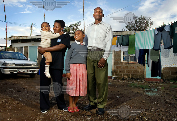 Boniface Kigotho Kamau and Pauline Wanjiku pose for a family photograph with their daughters, Joyce Muthoni and two year old Sharon Wanjiru.