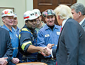 """United States President Donald J. Trump shakes hands with coal miners prior to signing H.J. Res. 38, disapproving the rule submitted by the US Department of the Interior known as the Stream Protection Rule in the Roosevelt Room of the White House in Washington, DC on Thursday, February 16, 2017.  The Department of Interior's Stream Protection Rule, which was signed during the final month of the Obama administration, """"addresses the impacts of surface coal mining operations on surface water, groundwater, and the productivity of mining operation sites,"""" according to the Congress.gov summary of the resolution.<br /> Credit: Ron Sachs / Pool via CNP"""