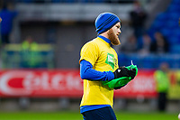 Aron Gunnarsson of Cardiff City warms up ahead of the Sky Bet Championship match between Cardiff City and Wolverhampton Wanderers at the Cardiff City Stadium, Cardiff, Wales on 6 April 2018. Photo by Mark  Hawkins / PRiME Media Images.