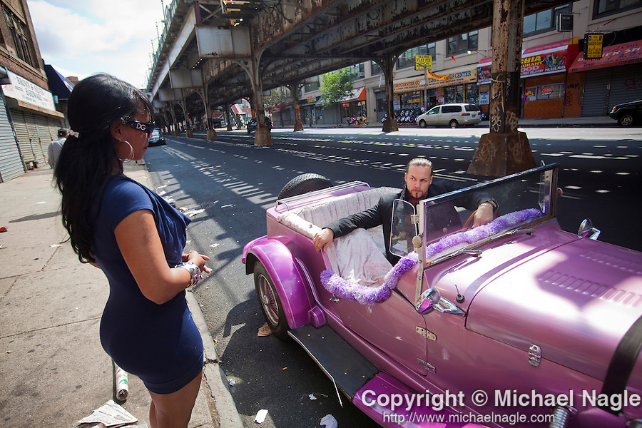 BRONX - JUNE 28, 2009:  In his purple P-Rex roadster, Baron Ambrosia (Justin Fornal) films his Bronx public access cable show Bronx Flavor  with Xiomara Hernandez on on Westchester Avenue on June 28, 2009 in the Bronx. (PHOTOGRAPH BY MICHAEL NAGLE)