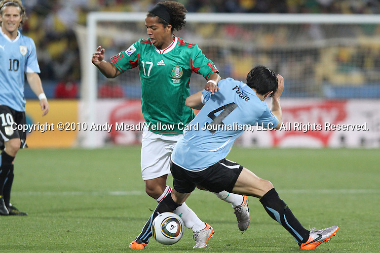 22 JUN 2010: Giovani Dos Santos (MEX) (17) and Jorge Fucile (URU) (4). The Uruguay National Team defeated the Mexico National Team 1-0 at Royal Bafokeng Stadium in Rustenburg, South Africa in a 2010 FIFA World Cup Group A match.