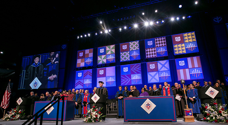 Chaplain Tom Judge, offers an invocation Sunday, June 11, 2017, during the DePaul University Driehaus College of Business commencement ceremony at the Allstate Arena in Rosemont, IL. (DePaul University/Jamie Moncrief)